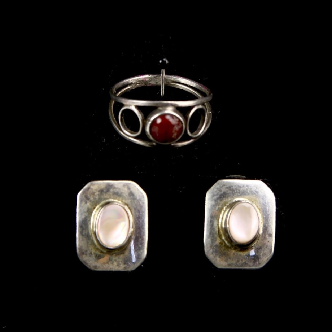 Silver Ring and A Pair of Silver Earrings