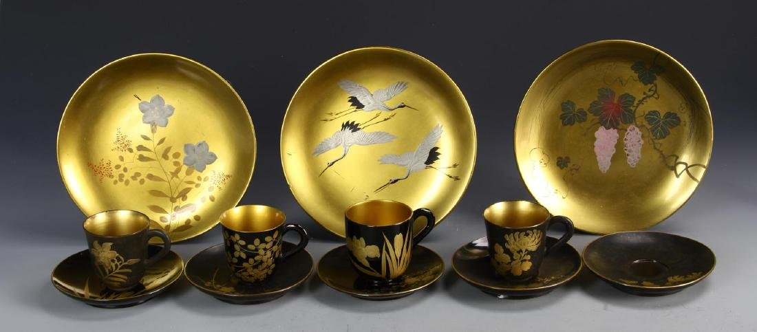 A Group Of Twelve Lacquer Plates And Cups