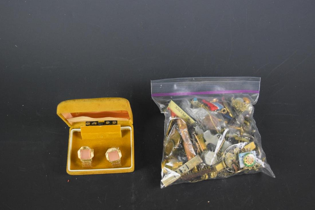 A Bag of Metal Tokens and Costume Jewelry
