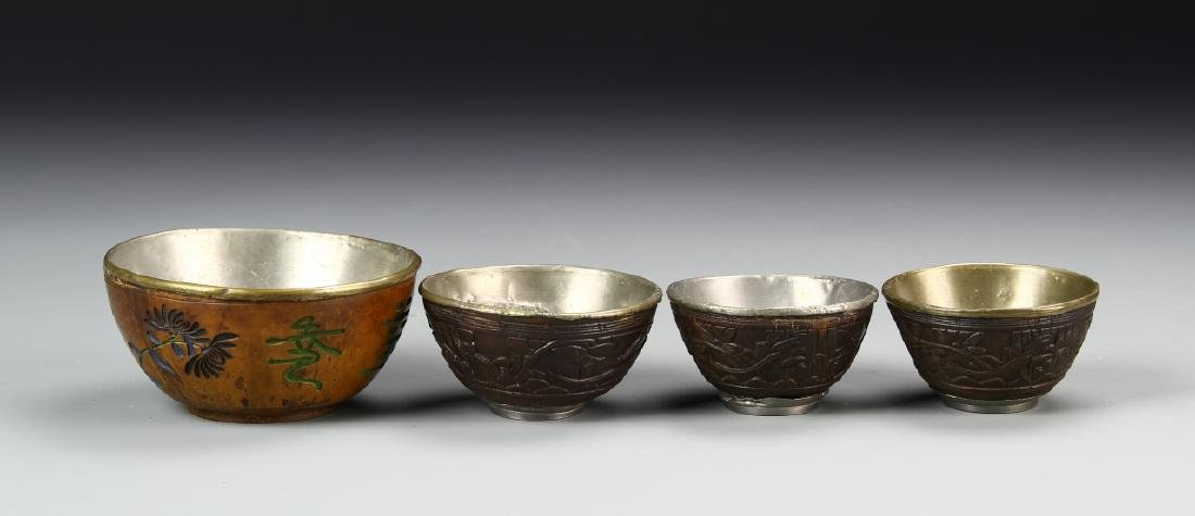 Four Chinese Hardwood and Coconut Bowls