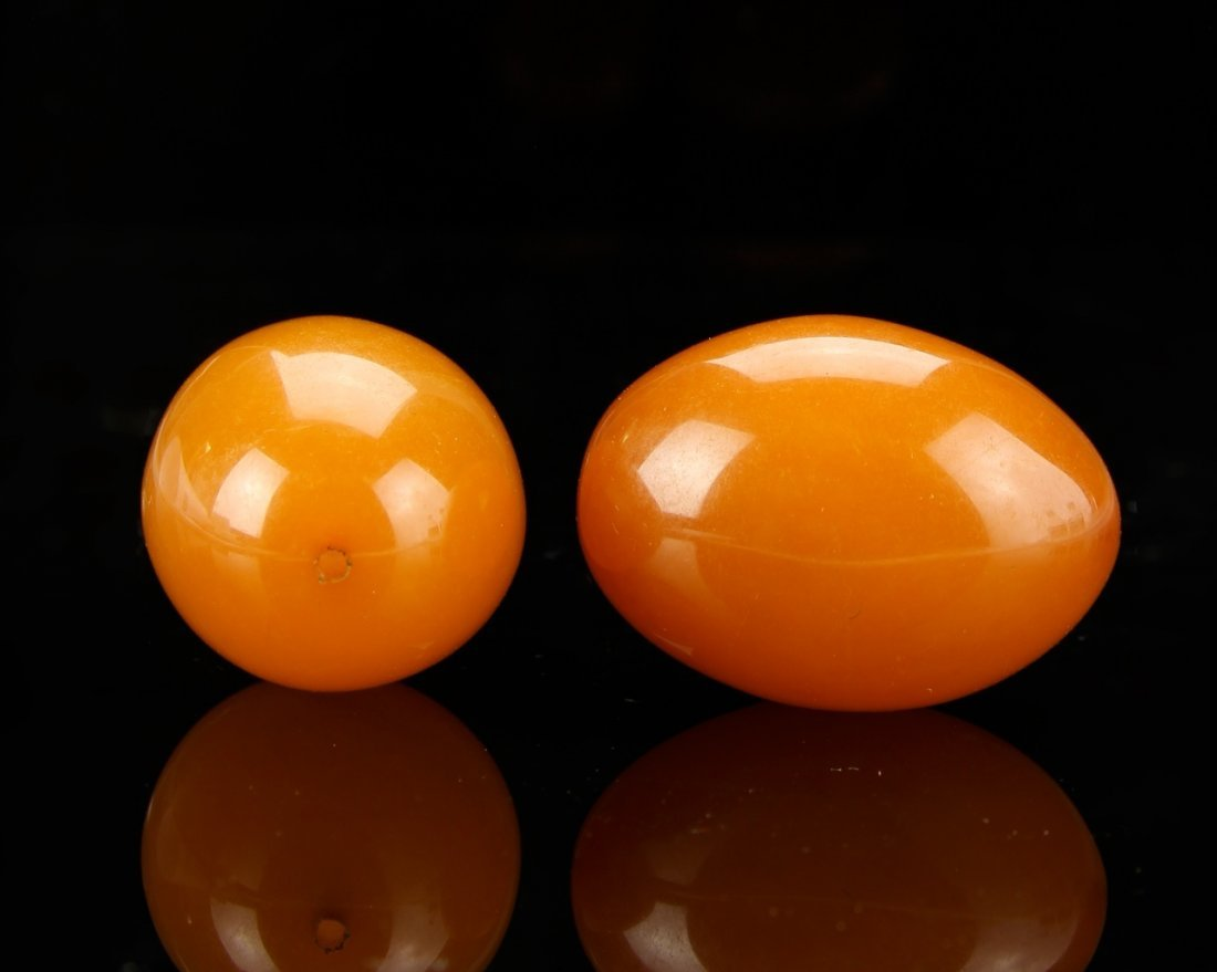Two Chinese Amber Beads