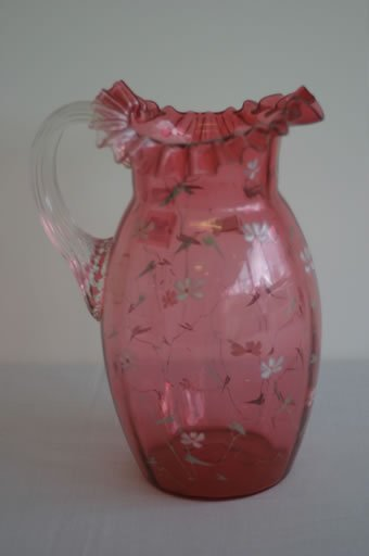 1: Victorian cranberry glass jug with handker
