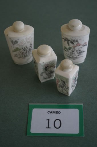 10: Two pairs of Japanese decorated bone scen
