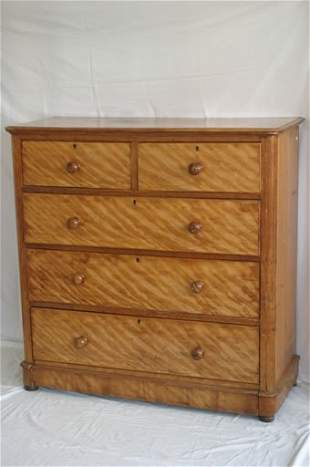 A Victorian satinwood chest of drawers f