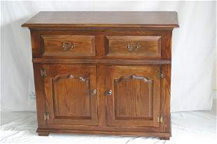 A small contemporary oak sideboard with