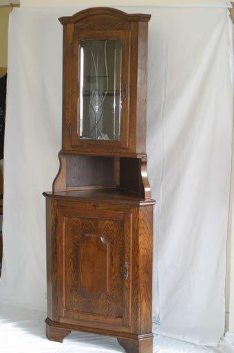 509: An oak antique style corner display cupb