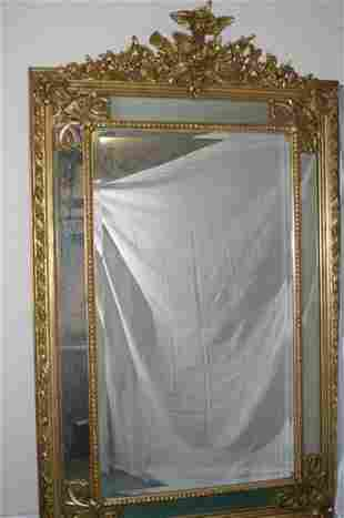 Large giltwood cushion mirror decorated
