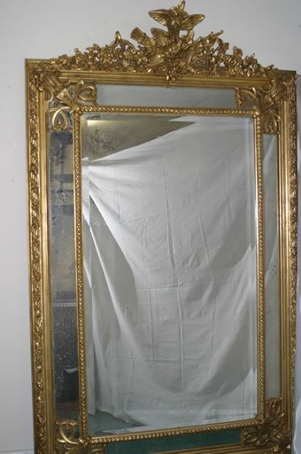 524: Large giltwood cushion mirror decorated