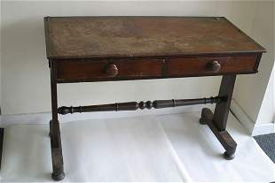 A Victorian two drawer side table with t