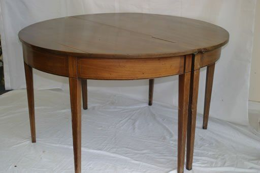 534: A Georgian mahogany 'D' end dining table