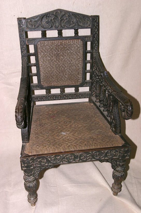 3002: 19c intensely carved armchair with original ratta