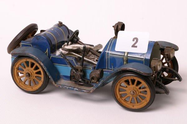 1002: Tin plated Schuco Mercer 1225 car play worn