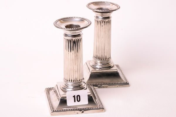 1010: Pair of silver five inch Corinthian column candle