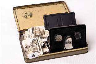 1015: Tin stereo-graph viewer with assorted black and w