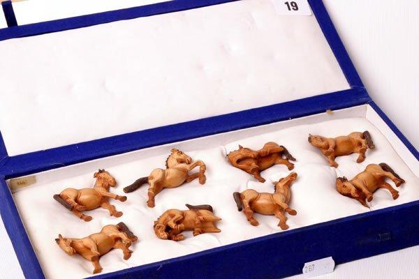 1019: Boxed set of eight model horses