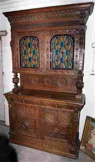 Continental carved oak buffet with leaded glass p