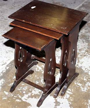 Nest of three tables with lyre shaped ends in oak