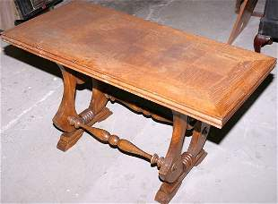 Oak coffee table with carved and shaped lyre ends
