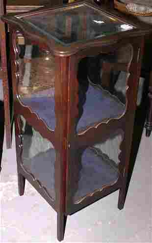 Mahogany bijouterie cabinet with shaped wooden si