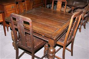 1940s oak drawer leaf table with four matching ch
