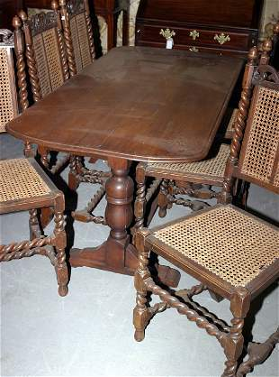 Oak refractory table and six oak carved chairs wi