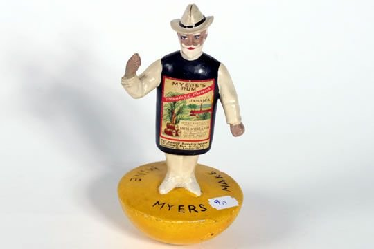 1009A: Wooden Myers Rum advertising figure on wobbly ba