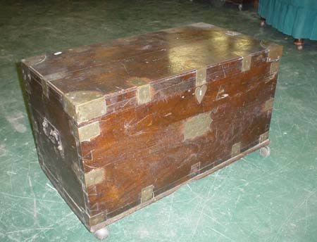 1984: A camphor wood brass bound campaign trunk bears p