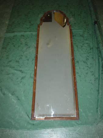 11003: A William & Mary style walnut framed wall mirror
