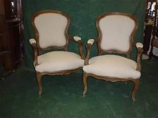 Pair of 19c carved walnut framed upholstered elb