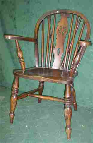 Elm Windsor elbow chair with wheel back carved s
