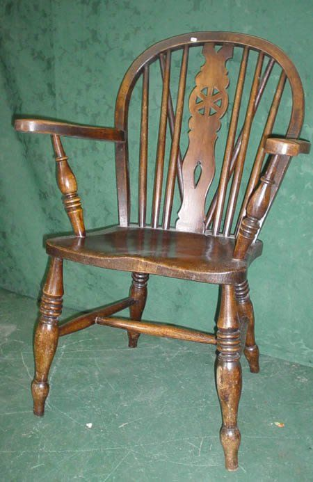 11021: Elm Windsor elbow chair with wheel back carved s