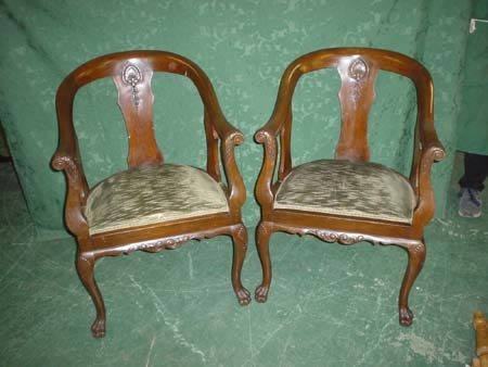 11023: Pair of mahogany framed tub back elbow chairs on