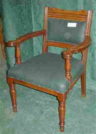 Good quality walnut elbow chair on tapering legs