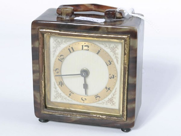 1004: Small toitorshell cased bedside clock, not in wor