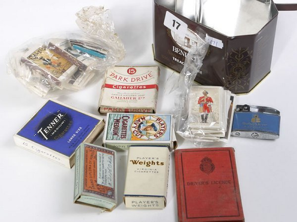 1017: Tin containing smoking related items, matchbooks,