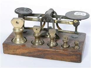 Small set of oak and brass postal scales with wei