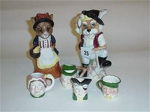 Collection of four miniature character jugs plus