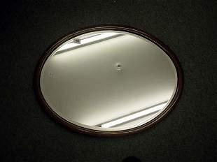 Edwardian mahogany inlaid framed oval bevel edged