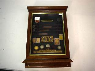Small case of decorative miniature golfing items