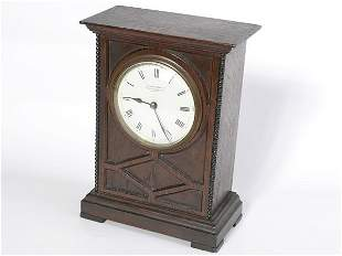 Oak cased mantle clock by Camerer Cass and Co. Ox
