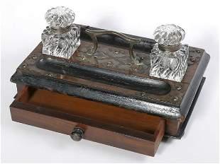 Wood inkstand with drawer on bun feet, metal trim