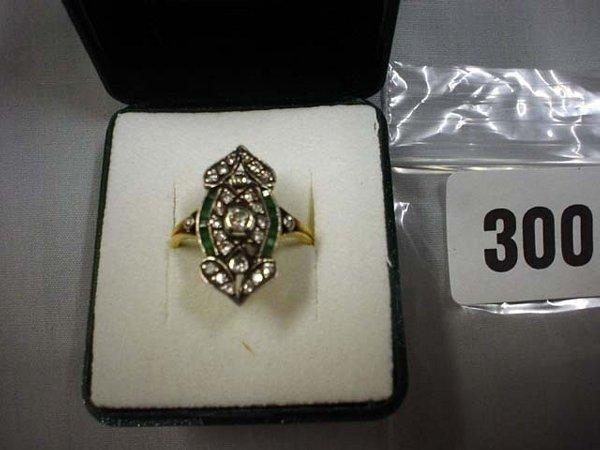 1300: Superb Art Deco emerald and diamond dress ring