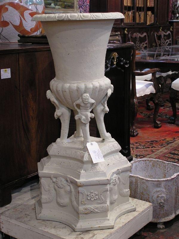 12: Pair of White Cast Iron Urns