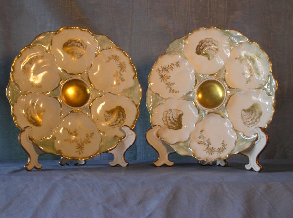 8: Two Green and White Oyster Plates with Gold Detail