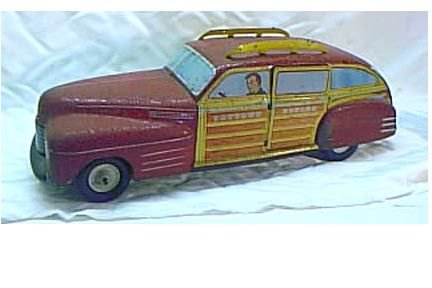 3003: Lithographed Tin Car By WYANDOTTE Toys
