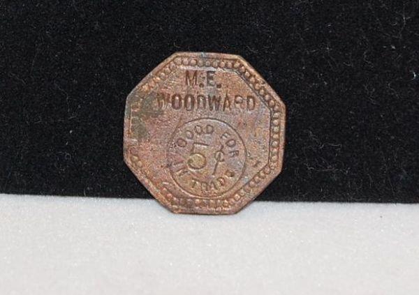 1020: 1862  M.E. WOODWARD 5 CENT TRADE COIN