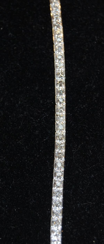 2005: .52 TCW DIAMOND BRACLET SET IN 14K WHITE GOLD