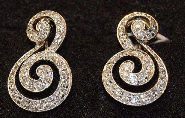 2007: 3.27 TCW DIAMOND EARRINGS SET IN 14 KT GOLD