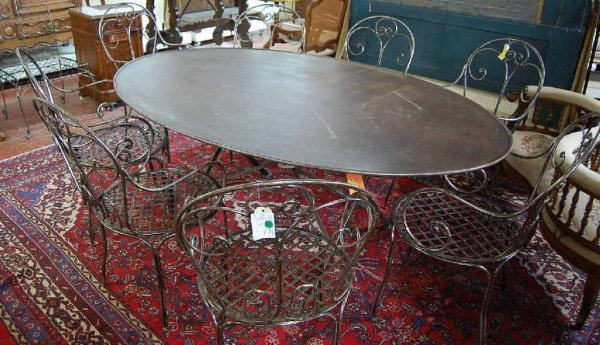 2008: LARGE OVAL FRENCH STEEL DINING TABLE
