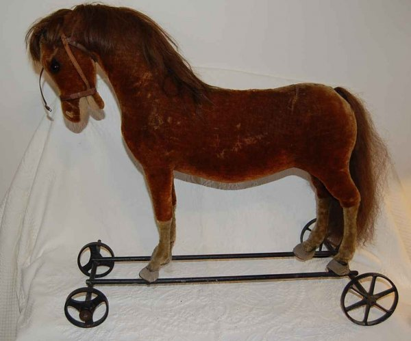 504: EARLY HORSE PULL TOY ON WHEELS